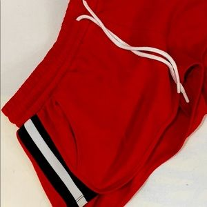 Garage Red shorts with elastic stripes on sides.